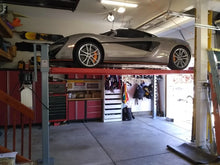 Exotic hyper-car being safely stored on Advantage's Heavy Duty 4-post Lift