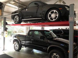 Advantage's 9,000 Pound Extra Tall and Long 4-post lift storing two vehicles