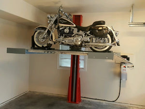 Advantages single-post vehicle lift creating space by lifting a motorcycle in a home garage