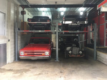 Two Advanatage 9,000 Pound 4-post lifts storing four classic cars in a two car space