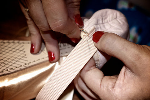 Sewing elastic into pointe shoes