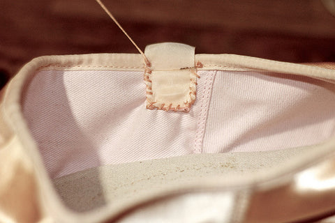 Sewn pointe shoe ribbon