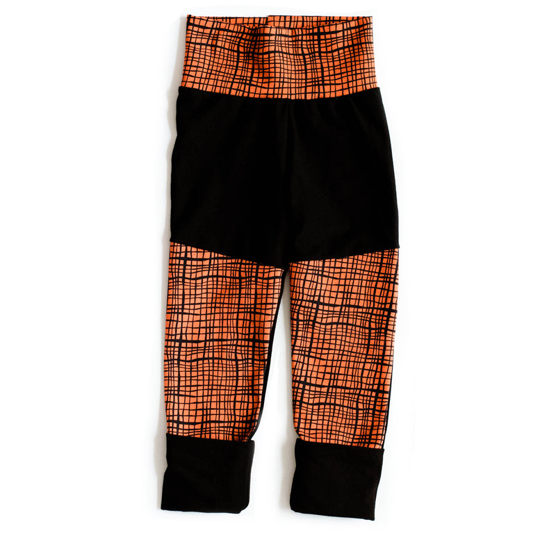Grow Along Pants with Black Cuffs | Orange and Black Grids