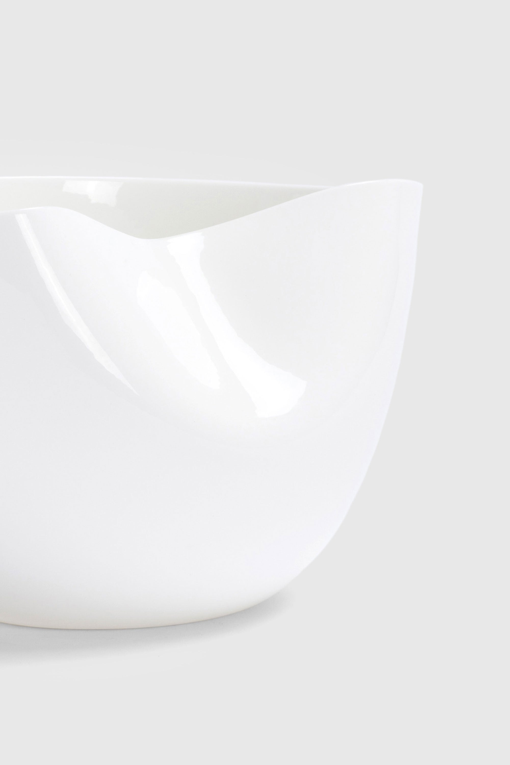 White Sculptural Fine Bone China Dented Bowl designed by Bodo Sperlein