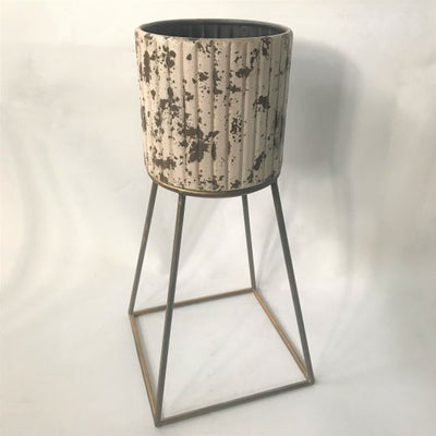 Metal flower pot on a stand