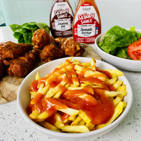 chicken and chips with ketchup and BBQ sauce