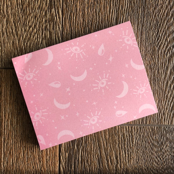 All seeing pink notepad