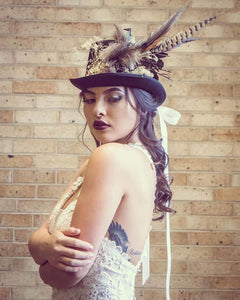 FEATHER AND FLOWER TOP HAT