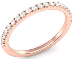 Rose gold wedding band with diamonds.