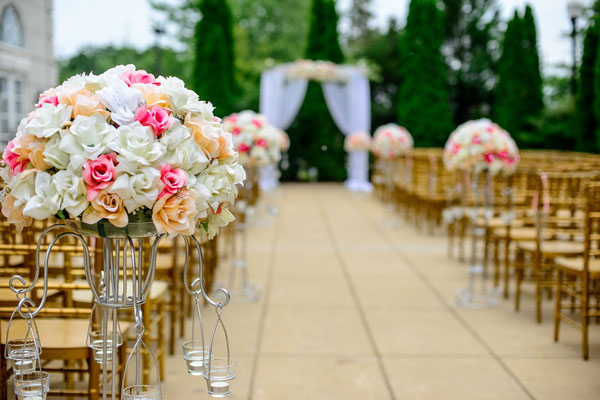 An outdoor wedding venue with white and pink flowers
