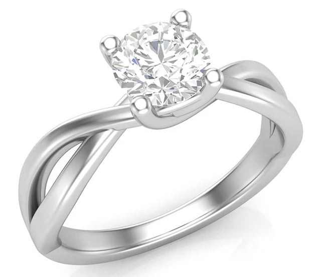 A white gold and diamond solitaire ring