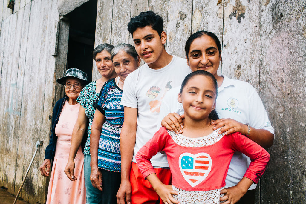 UNOCACE COOPERATIVE, ECUADOR - 2017: For three generations, the Borja family farm located in the hillside along Montalvo has been owned and operated by women. Today, </span>Margoth Marciela Borja Naranjo owns and operates the farm while her younger brother Antony Joel Borja Naranjo (third from right), studies at the local college. It's Margoth's hope that someday, her daughter Joselyn (front), will carry on the family's matriarchal legacy. (Photo by Brenton Gieser)