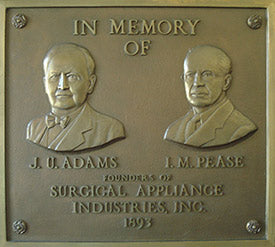 Metal plaque commemorating the two founders of SAI Brands