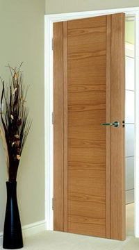 Capri Oak Flush Door with V Grooves is Satin Prefinished