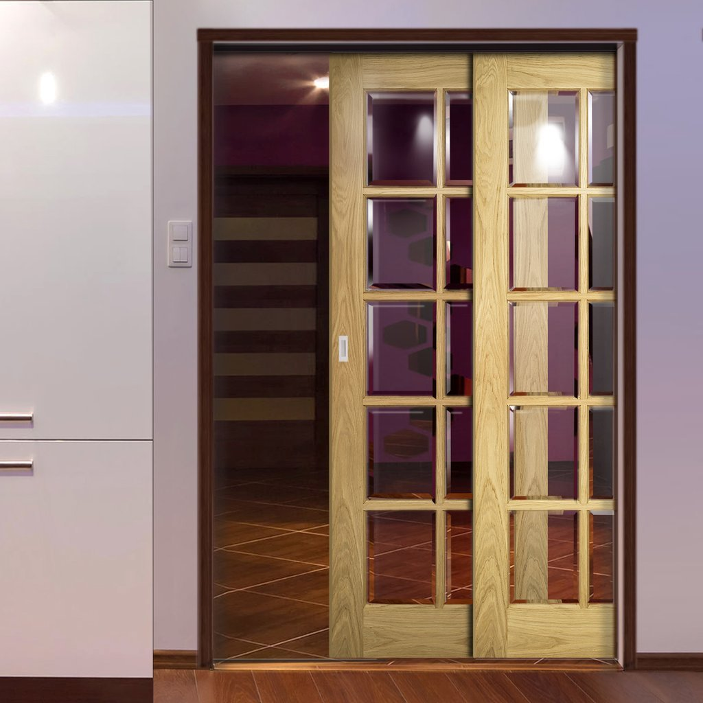 Bristol Oak Veneer Staffetta Twin Telescopic Pocket Doors - 10 Pane Clear Bevelled Glass - Unfinished