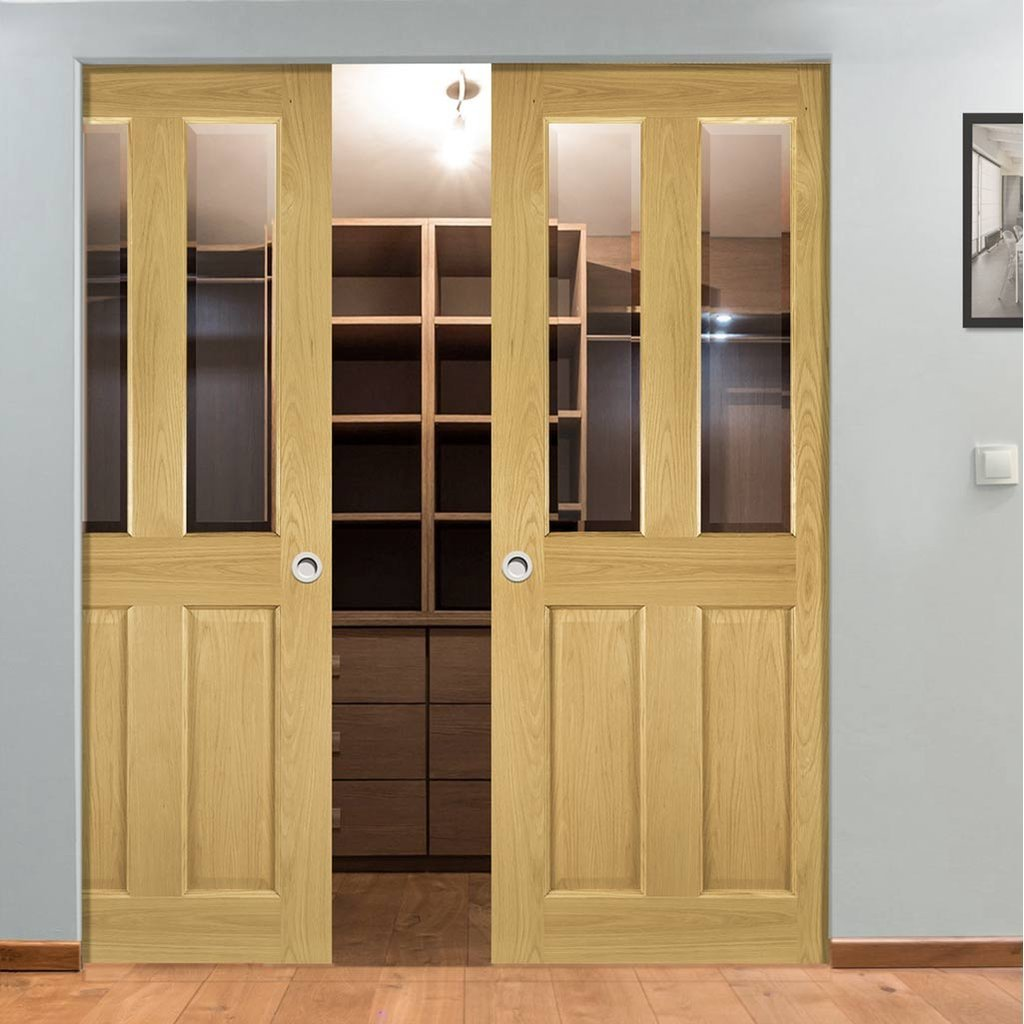 Bury Oak Absolute Evokit Double Pocket Doors - Clear Bevelled Glass - Prefinished