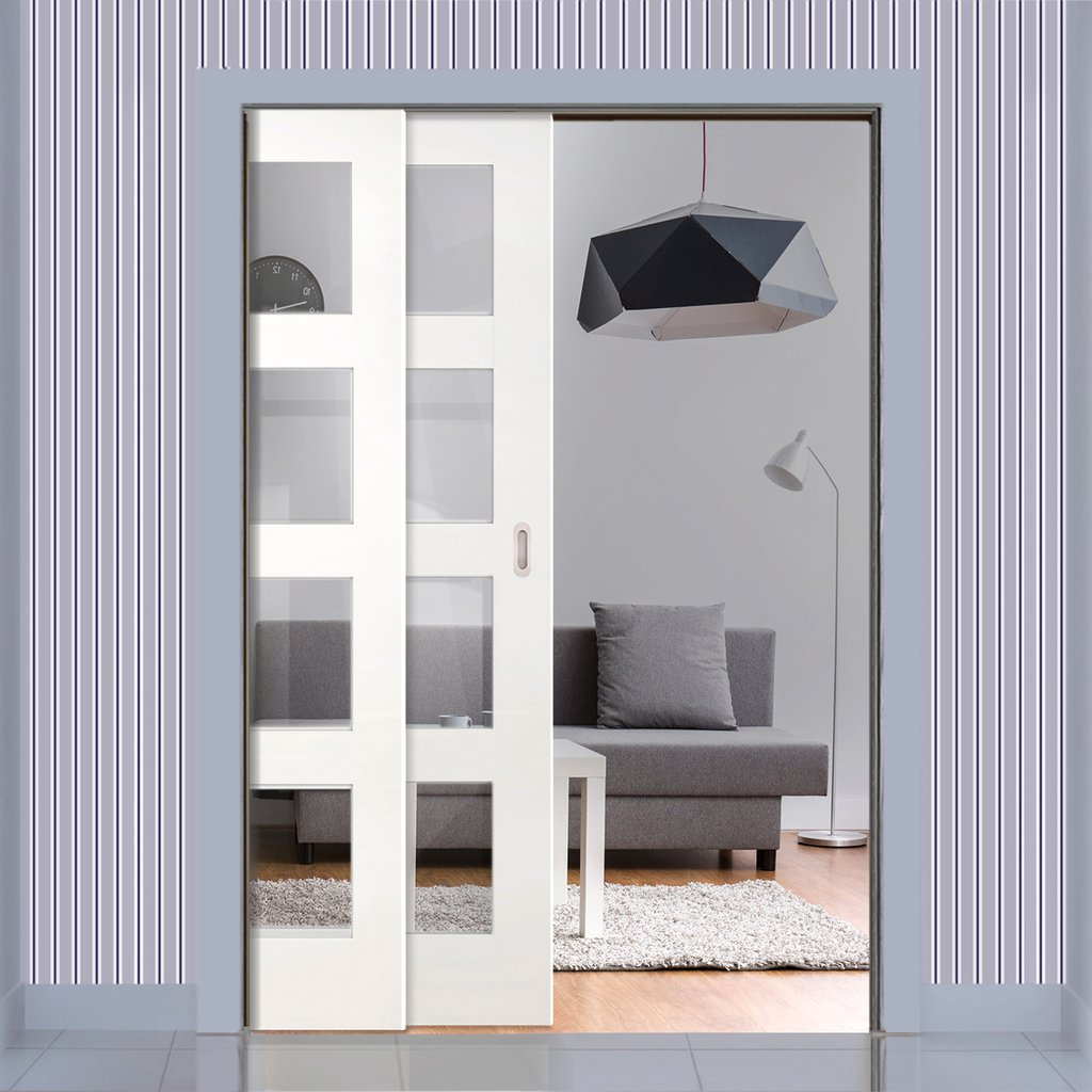 Coventry Shaker Staffetta Twin Telescopic Pocket Doors - Clear Glass - White Primed