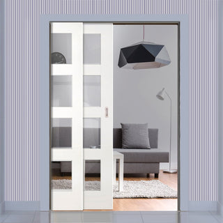 Image: Coventry Shaker Staffetta Twin Telescopic Pocket Doors - Clear Glass - White Primed