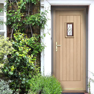 Image: Image of a polished chrome door handle on oak door and the locking system