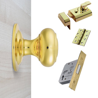Image: External M51 Centre Knob Front Door Handle Pack - Brass Finish