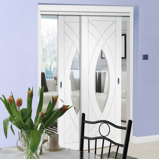 Image: Two Sliding Doors and Frame Kit - Treviso Oak Door - Clear Glass - White Primed