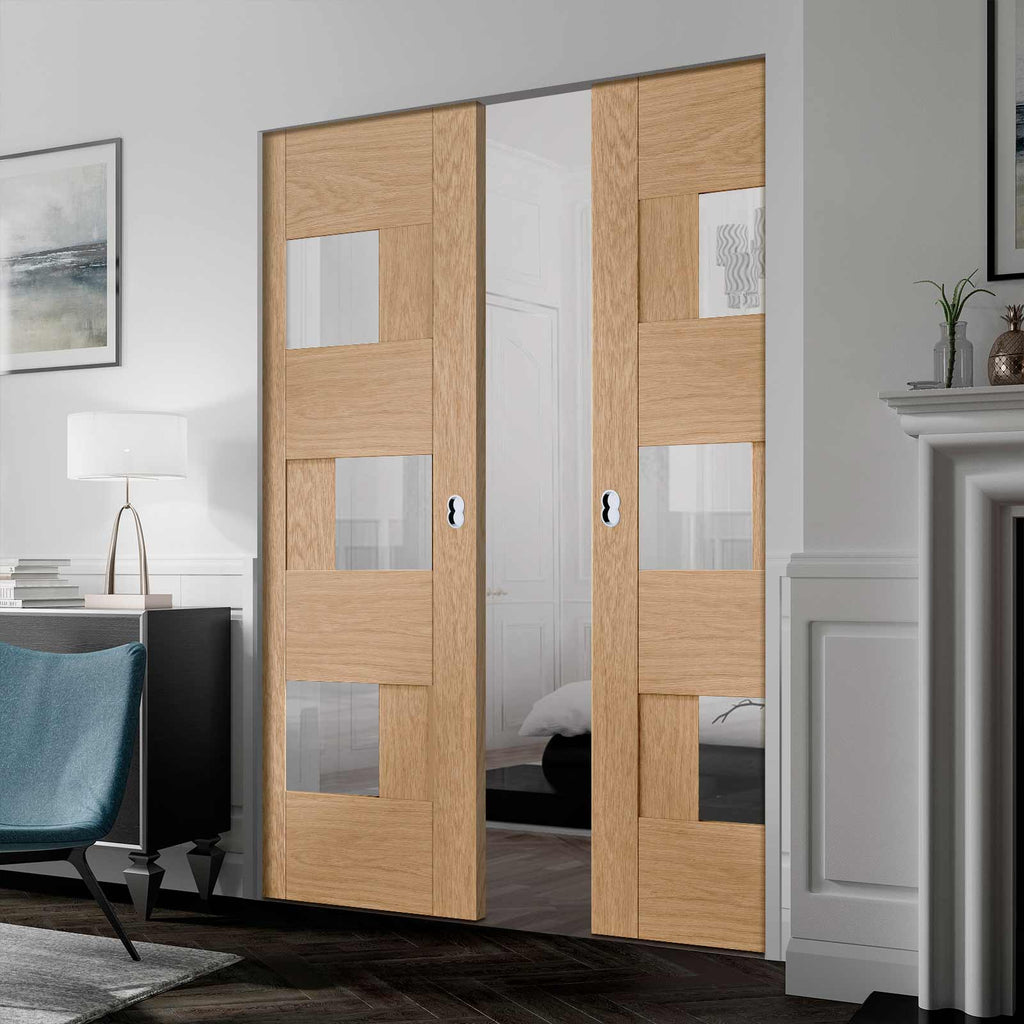 Perugia Oak Panel Absolute Evokit Double Pocket Door - Clear Glass - Prefinished