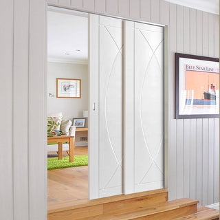 Image: Pesaro Staffetta Twin Telescopic Pocket Doors - Primed