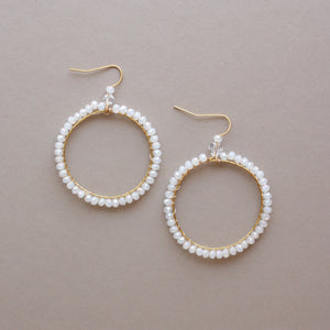 White beads round drop earrings