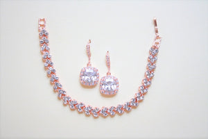 Rose Gold Halo Dropped Earring And Bracelet Set