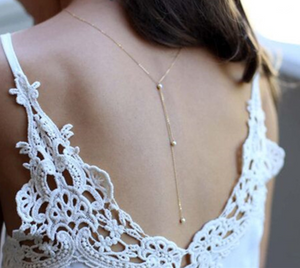 Gold and pearl back drop necklace