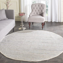 Hand Woven Ivory and Multi Cotton Area Rug