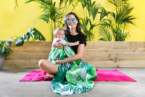 Mama Rules extra large baby muslin in a tropical print. Used as a breastfeeding cover.