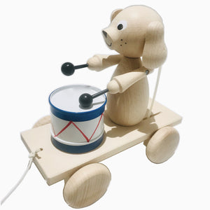 Handmade, high quality wooden toys for children and babies. Pull along along wooden toy drummer dog from Ella & Frederik available at Suzemu gift shop.