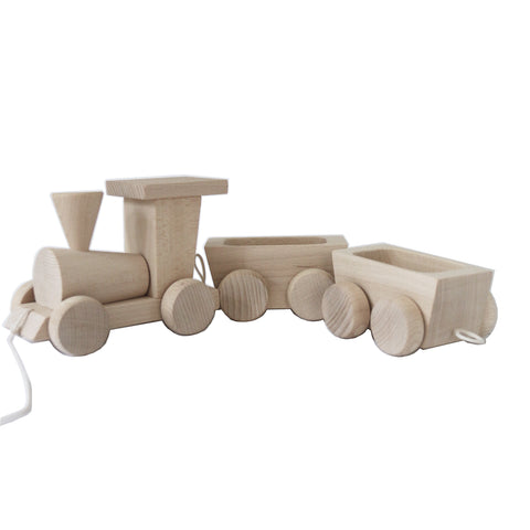 Handmade, high quality wooden toys for children and babies. Pull along wooden train set toy from Ella & Frederik available at Suzemu gift shop.