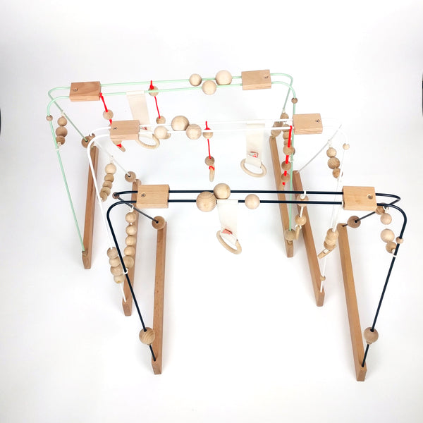 A selection of Scandi style Wooden Baby Gyms perfect for the modern minimalist nursery decor.