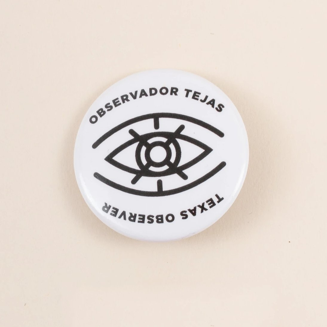 Monogram Eye Logo Button