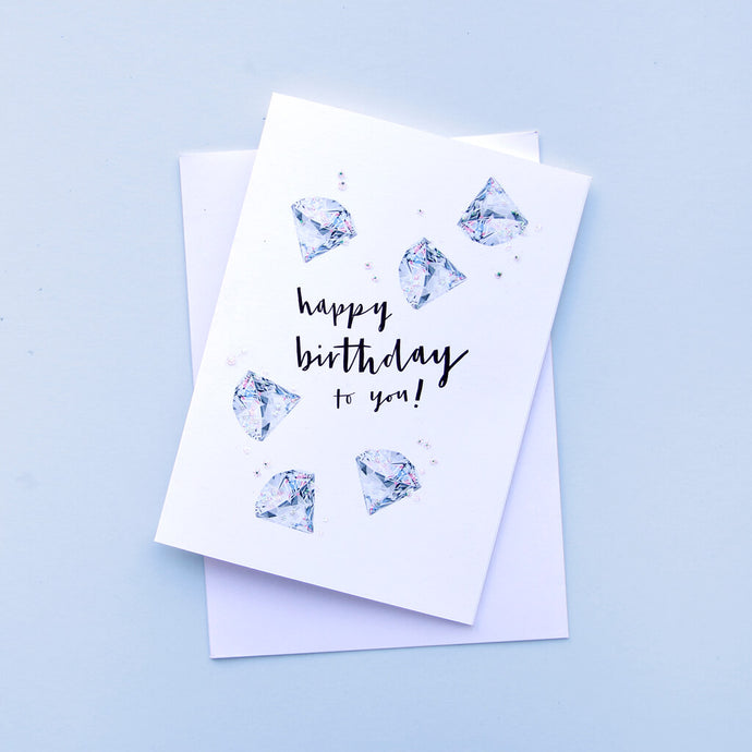 birthstone card for April birthdays featuring tiny diamond illustrations
