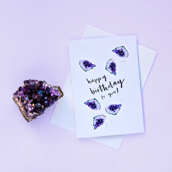 February birthstone birthday card featuring tiny illustrated amethysts