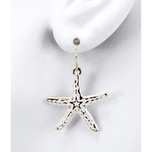 Gold Starfish Dangle Earrings With White Epoxy - Costume Jewelry