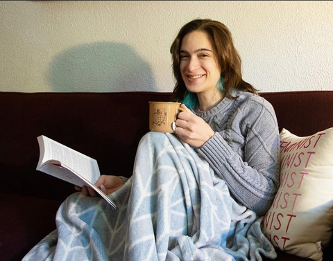 Woman with book drinking fake coffee