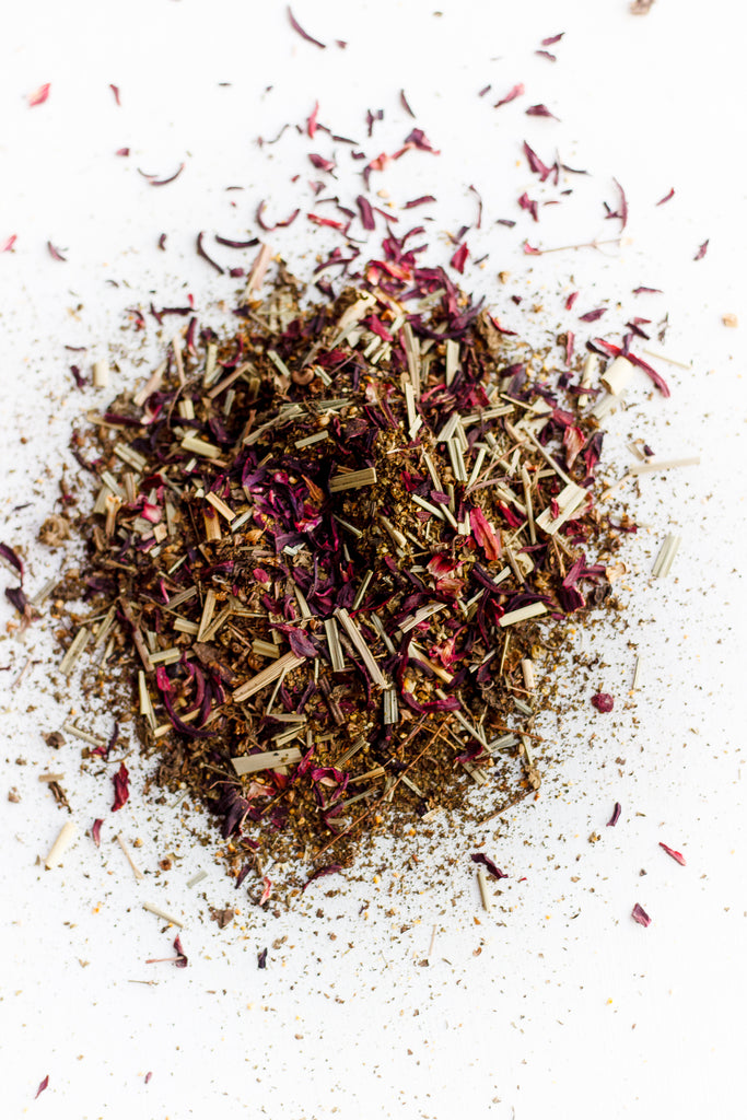 Blushing tea ingredients hibiscus, lemongrass, and tulsi