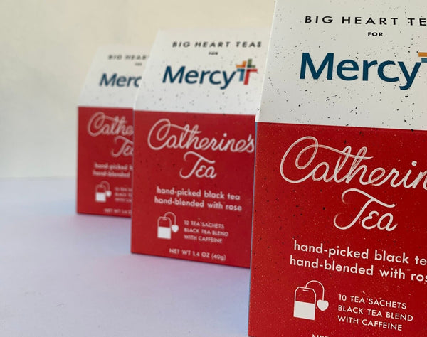 "Boxes of ""Catherine's Tea"" black tea with rose for Mercy Health by Big Heart Tea Co."