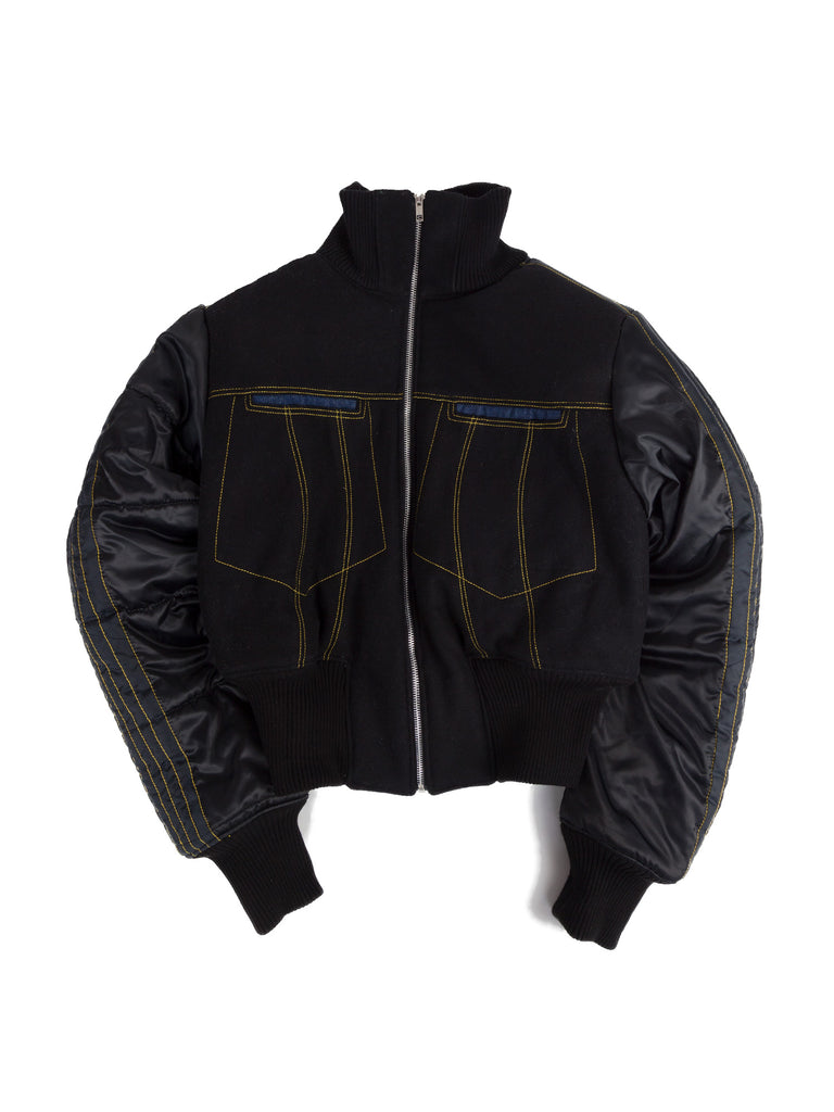 A boxy medium to light weight bomber jacket with an 80s power shoulder silhouette that tapers into a fitted waistline. Featuring Rue-L signature top stitching details, shoulder pads, a soft-touch fleece lining, denim faced pockets and chunky ribbing.
