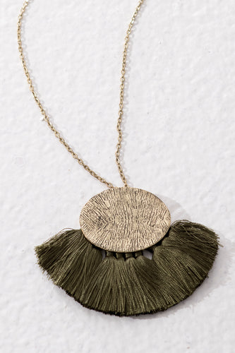 Handmade fair trade jewellery with long chain and textured golden brass pendant. Olive green tassels
