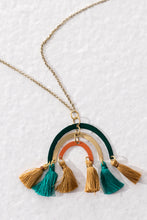 Ethical long necklace with brass rainbow-like pendant and multi-coloured tassels. Handmade in India.