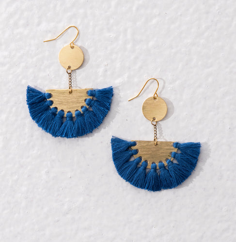 Golden brass drop earrings with royal blue tassels. Statement ethical jewellery available in the UK