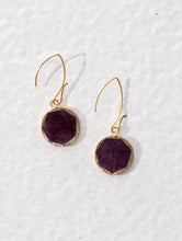 Reversible fair trade earrings that have a purple and a white side. Ethically made.