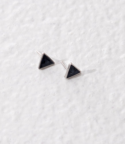 Ethically made small triangular stud earrings made with white pearl grey on a silver brass base.