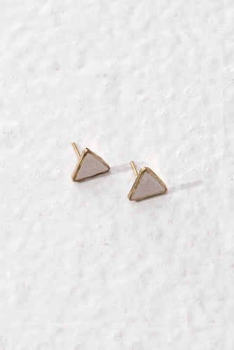 Ethically made small triangular stud earrings made with white enamel on a golden brass base.