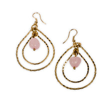 Earrings with pink stone enveloped by concentric golden tear drops. Ethical sustainable jewelry.